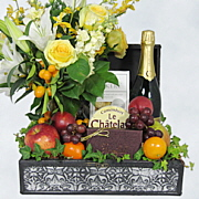 Champagne gift with flowers, cheese, chocolate in a unique wood chest