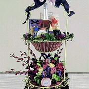 Two tiered wrought iron stand with flowers, moscato, artisanal cheese and other fine foods.