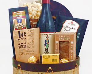 wine gift basket in a decorative drum with gourmet treats