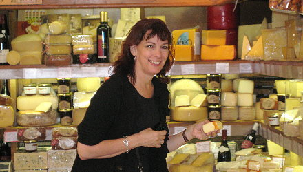 Terry August sampling cheeses for our gift baskets in Paris, France