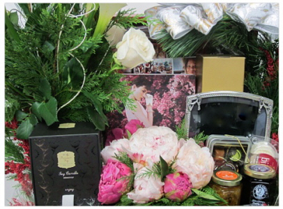 a custom basket using flowers, books, and other gifts for the former First Lady