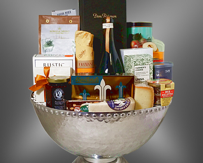 A silver urn holding Dom Perignon, wine, cheese , chocolates and more
