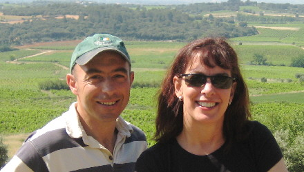 Terry August and Sylvain Fadat overlooking his Aupilhac vineyard in Montpeyroux, France for our wine gift baskets.