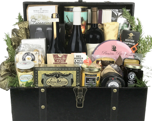 a large wood chest containing wines, cheeses, and other food items