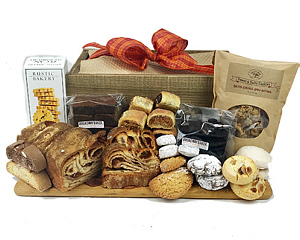 An assortment of cookies, rugulach, brownies, babka,