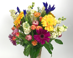 a floral arrangement of bright and beautiful flowers that will cheer anyone up