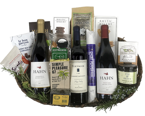 three California wines, artisan cheese, crackers, chocolates and more in a gift basket arrangement