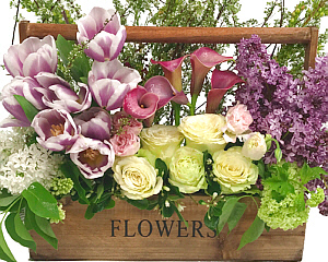 a garden style flower arrangement in a wood box with FLOWERS engraved on the front holds this seasonal arrangement - click for more details