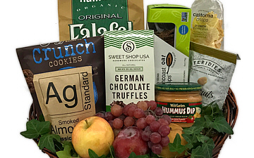 a holiday basket with fine foods and wine