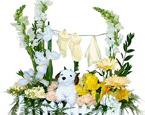 a garden style flower arrangement with baby booties hanging from what looks like a clothesline