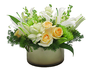 a champagne-colored vase filled with roses, lilies, and stock