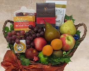 a wicker basket with fresh fruit and other items