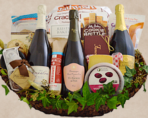 a large wicker basket holds Champagne and sparkling wines, cheese, chocolate and other appropriate foods