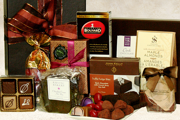 a gift box containing premium chocolates, chocolate truffles, chocolate cookies and other chocolaty delights