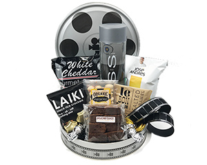 a decorative film reel tin containing Voss water and snacks