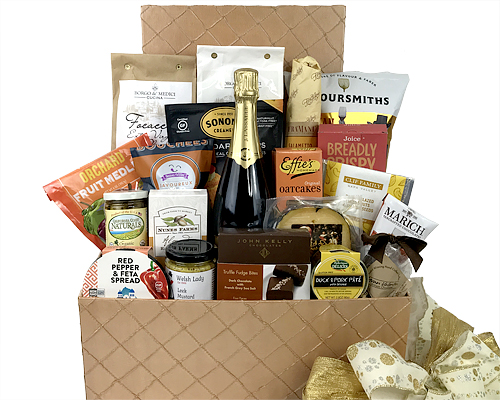 A hand-crafted champagne in a large gold box accompanied with fine cheese, chocolate, olives, almonds and other delights.