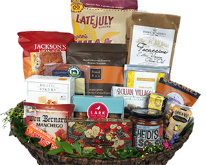 a very large basket with chocolates, salsa, chips, cheese and more