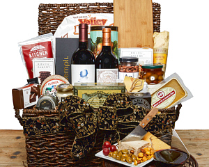a large hamper-style basket with 2 premium red wines, sempli glasses, cheese, pate, chocolates, charcuterie and other fine foods.