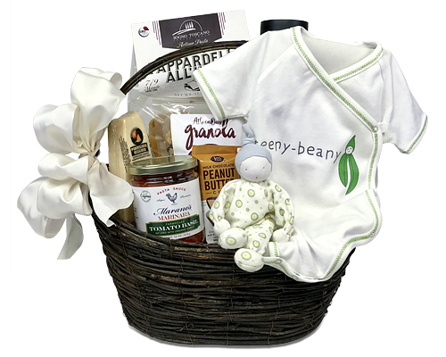 a basket for baby and family that includes foods like soup, pasta sauce, pasta as well as fine baby items.